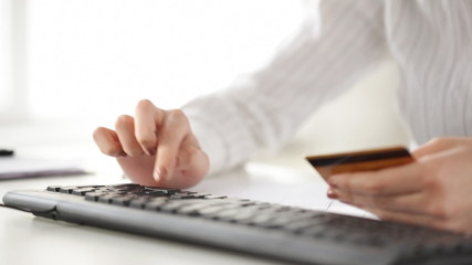 woman with credit card making internet shopping