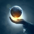 Image of earth planet on hand