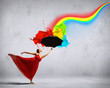 Ballet dancer in flying silk dress with umbrella