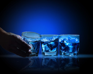 Three glasses of blue liquid