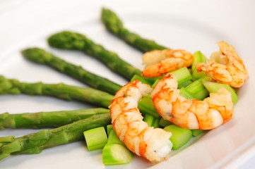 Shrimps and asparagus, plate with fresh shrimps