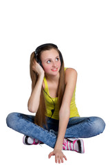 a girl in headphones listens to music and laughs