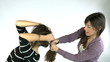 Woman pulling long hair to friend angry