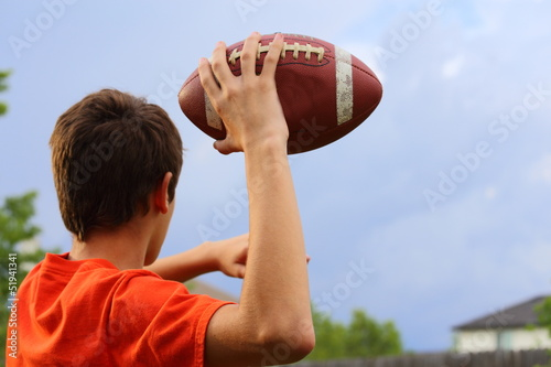 Throwing Football - 51941341