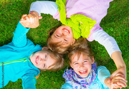 kids lying on the ground