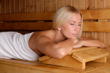 Beautiful blond girl enjoying in the sauna