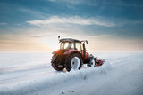 Tractor cleaning snow