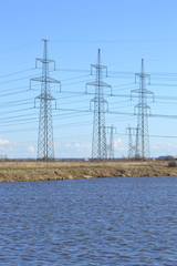 Spring landscape with electricity pylons