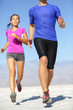 People running - runner fitness couple in desert