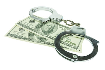 Handcuffs with money isolated in white background