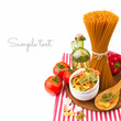 Italian pasta with vegetables on striped tablecloth