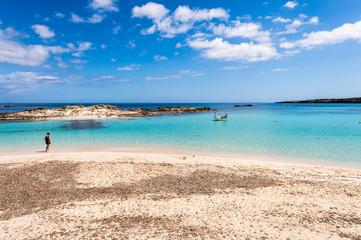 Tourist visiting Els Pujols beach in Formentera island, Mediterr