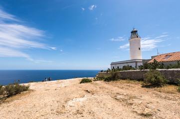 Tourists visiting Formentera La Mota lighthouse mediterranean Se
