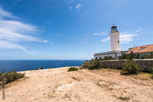 Tourists visiting Formentera La Mota lighthouse mediterranean Se