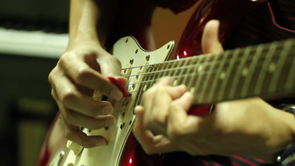 guitarist play electric guitar in studio