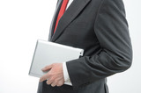 Businessman carrying digital tablet