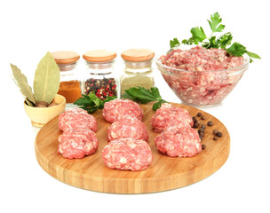 Raw meatballs with spices isolated on white