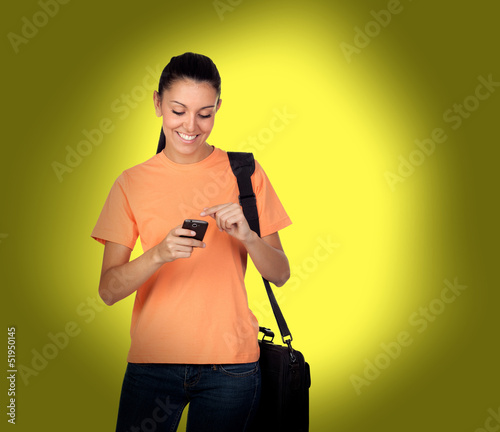Pretty brunette girl with a mobile