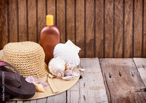 sun hat and sun lotion
