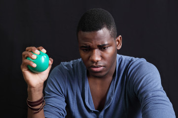 Stressed man with a stress-ball