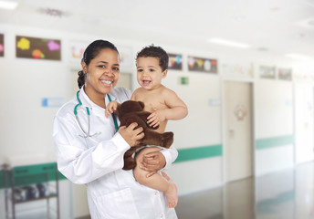 Latin pediatrician at the hospital with a baby
