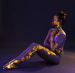 Image of sexy brunette with UV pattern on body