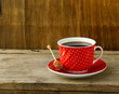 Red cup of coffee for breakfast on  wooden board
