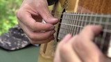 Playing the Guitar. Slow Motion at a rate of 480 fps