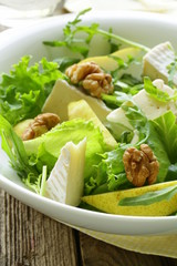 salad with pear, walnuts and cheese camembert
