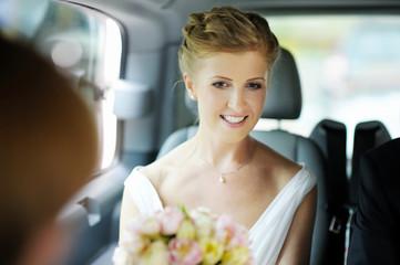 Bride sitting in a car