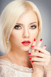 Blonde woman with bright red lips and manicure