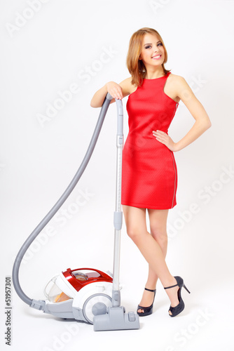 Attractive girl with vacuum cleaner