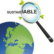 Sustainable earth looking from a magnifying glass