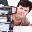 Woman looking at folders on the desk