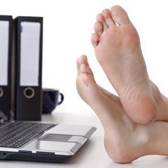 Bare feet on the desk