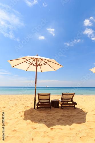 Leinwandbild Motiv beds and umbrella on the beach