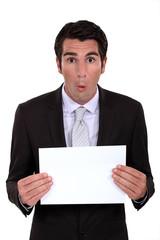 Businessman with a blank board