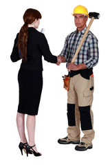 Architect and builder shaking hands