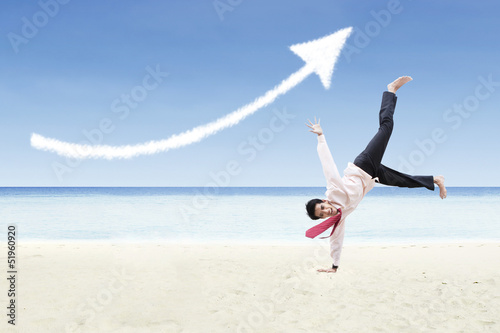 Businessman dance and increase arrow sign cloud at beach