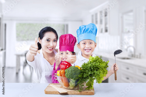 Happy family chef and vegetable at home
