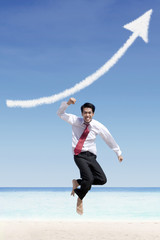 Successful businessman and increase arrow sign cloud at beach