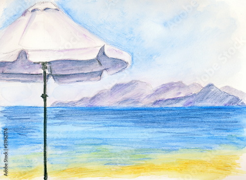 A white umbrella at the beach