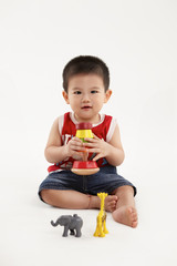 Young kid playing with colorful toys