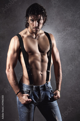 Sexy man shirtless with suspenders
