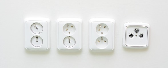 Closeup shot with white sockets and one radio TV socket.