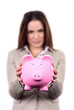 woman with pink piggy bank