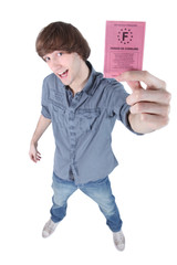 Boy showing driving licence