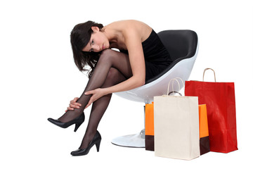 Women sat surrounded by shopping bags