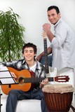 Father and son in music rehearsal