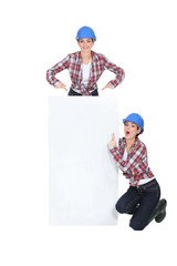 Manual worker with a board left blank for your message